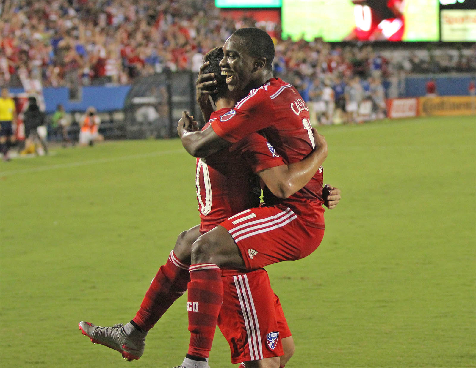 Fabian Castillo and Mauro Diaz celebrate their goal and assist against NE Revolution on July 4, 2015. Photo by David Chaffin for Soccer Information Network