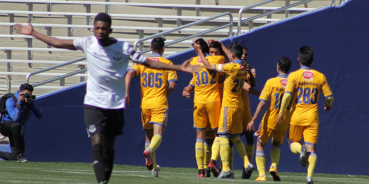 Tigres players celebrate Luis Cruz's goal against Everton FC in the Cotton Bowl on Sunday. Photo by David Chaffin